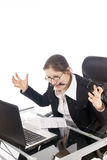 Frustration. A young and frustrated woman, working in her office. Isolated on white Royalty Free Stock Photography