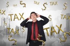 Frustration asian businessman with tax time sign Royalty Free Stock Image