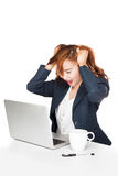 Frustration Asian office girl look at PC Stock Photography