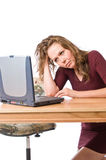 Frustration at the laptop computer. Pretty young woman shows annoyance towards her computer Stock Images
