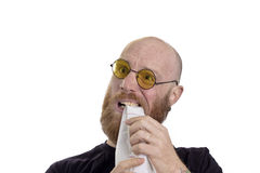 Frustration, man eating paper Stock Image