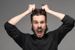 Frustration, man tearing hair out in anger Stock Photo