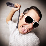 Frustration. Silly guy pulling his necktie Royalty Free Stock Image