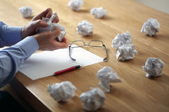 Frustration stress and writers block. Tearing up another crumpled paper ball for the pile Stock Photo