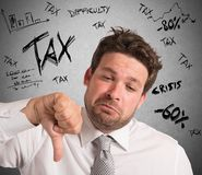 Frustration for taxes. Businessman with negative expression for crisis taxes Royalty Free Stock Photos