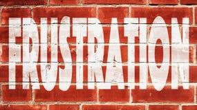 Frustrazione su un muro di mattoni Fotografia Stock