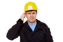 Frustrerad arbetare över isolerad vit Arkivbild