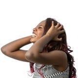 Frustrerat afrikanskt tonårigt med händer i hår Royaltyfria Bilder
