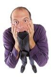 frustrierte beißende Krawatte des Geschäftsmannes lizenzfreie stockbilder