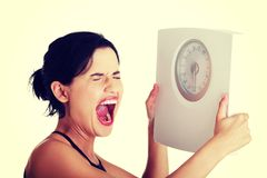 Frustrierte Frau mit Skala Lizenzfreies Stockfoto