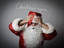 Frustrierte Santa Claus Konzept - Weihnachten wieder Lizenzfreies Stockbild