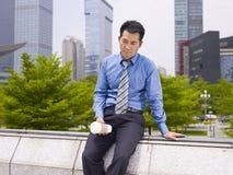 Frustrierter asiatischer Unternehmensleiter Stockbild