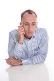 Frustrierter und deprimierter Manager lokalisiert auf Weiß. Stockbilder