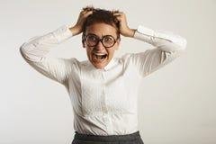 Frustrierter weiblicher Lehrer in der konservativen Kleidung Lizenzfreie Stockfotos