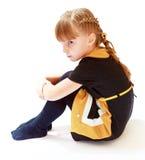 Frustriertes Mädchensitzen Stockfoto