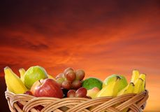 Frut. Basket of fruit with several banana, apple, grape Stock Photo