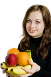 Fruta bonita da terra arrendada da menina Fotografia de Stock