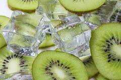 Fruta de kiwi con hielo Imagen de archivo libre de regalías