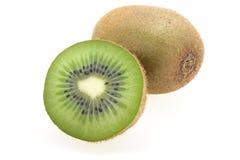 Fruta de kiwi cortada y entera Fotos de archivo