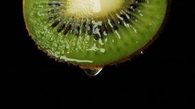 Fruta de kiwi rebanada almacen de video