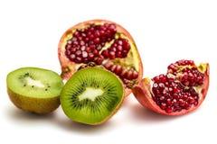 Fruta de la granada y de kiwi Foto de archivo libre de regalías