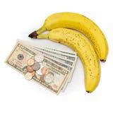 Fruta del plátano con el dinero Fotos de archivo