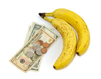 Fruta del plátano con el dinero Imagenes de archivo