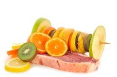 Fruta e carne Imagem de Stock