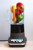 Fruta e verdura em um misturador do alimento Fotos de Stock Royalty Free