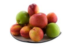 Fruta em uma placa imagens de stock
