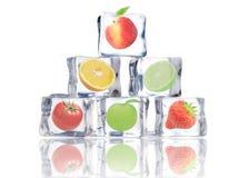 Fruta en cubos de hielo Foto de archivo libre de regalías