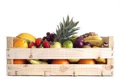 Fruta en rectángulo de madera Fotografía de archivo libre de regalías