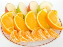 Fruta en una placa Imagen de archivo libre de regalías