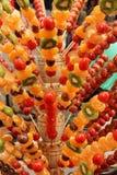 Fruta escarchada en un palillo Imágenes de archivo libres de regalías