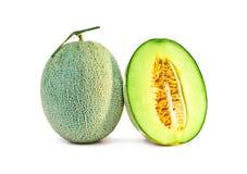 Fruta fresca del melón sola y media Fotos de archivo