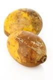 Fruta madura del bael en blanco Imagen de archivo