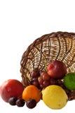 Fruta que se derrama fuera de cornucopia Imagen de archivo libre de regalías