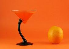 Fruta y jugo anaranjados Fotos de archivo