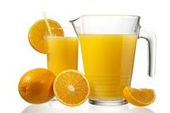 Fruta y jugo anaranjados fotografía de archivo