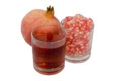 Fruta y jugo de la granada Imagen de archivo libre de regalías
