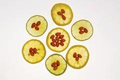 Fruta y limón anaranjados medicinales Foto de archivo