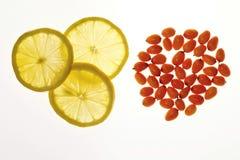 Fruta y limón anaranjados medicinales Foto de archivo libre de regalías