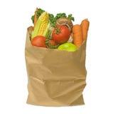 Fruta y verdura sana en una bolsa de papel marrón, aislada en a Imagen de archivo