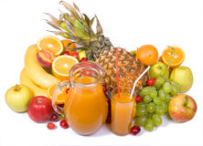 Frutas coloridas com suco imagem de stock