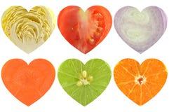 Frutas e legumes dadas forma coração Foto de Stock