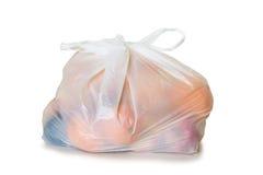 Frutas em um saco de plástico imagens de stock