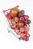 Frutas en carro de la compra Imagen de archivo libre de regalías