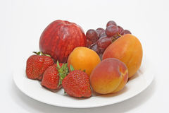 Frutas en la placa Imagen de archivo libre de regalías