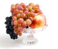 Frutas en un florero Foto de archivo