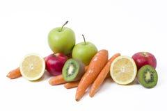Frutas en un fondo blanco Limón con las manzanas y kiwi en el fondo blanco Kiwi con el limón en un fondo blanco Foto de archivo libre de regalías